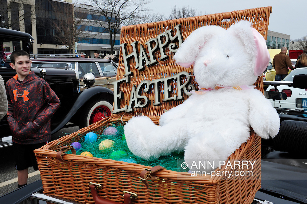 This Easter basket with Easter Bunny in it is on the trunk rack of black 1980 MG convertible at the 58th Annual Easter Sunday Vintage Car Parade and Show sponsored by the Garden City Chamber of Commerce. Hundreds of authentic old motorcars, 1898-1988, including antiques, classic, and special interest participated in the parade.