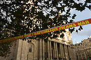Anti-capitalist message on stretched tape on the 11th day of the Occupy London protest camp in St Paul's cathedral churchyard, London 26/11/11. City lawyers are using medieval pedestrian bylaws to gain a court injunction to evict the activists who set up tents and shelters as in other countries.