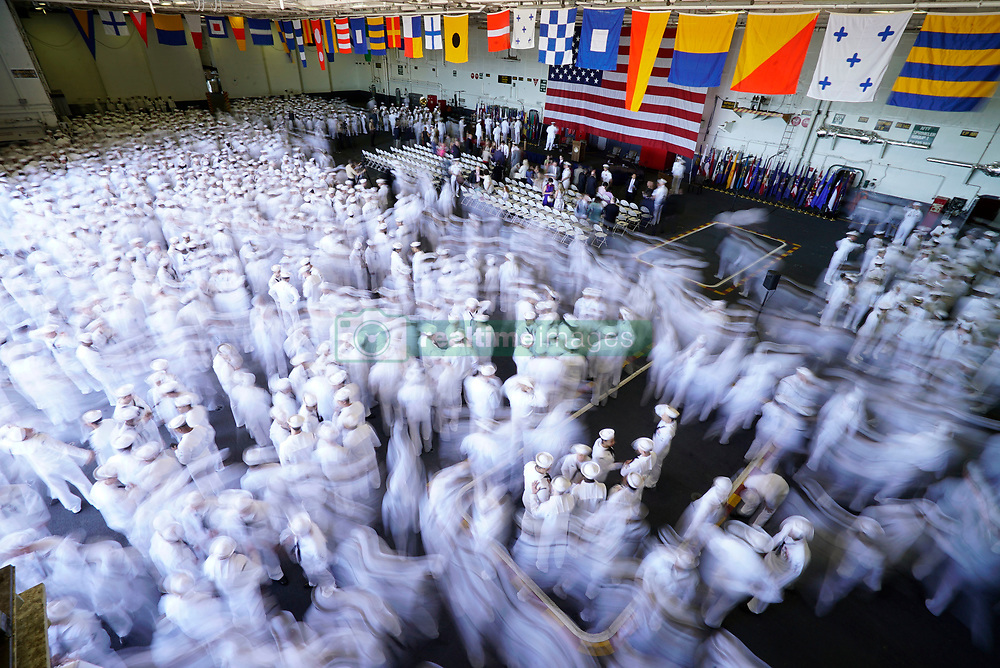 NORFOLK (May 15, 2017) Sailors disperse at the conclusion of a change of command ceremony held aboard Nimitz-class aircraft carrier USS Abraham Lincoln (CVN 72) in Norfolk, Va. Abraham Lincoln's change of command comes after the successful completion it's mid-life refueling and complex overhaul.  (U.S. Navy photo by Mass Communication Specialist 1st Class Mark Logico/Released)170515-N-WP746-109<br /> Join the conversation:<br /> http://www.navy.mil/viewGallery.asp<br /> http://www.facebook.com/USNavy<br /> http://www.twitter.com/USNavy<br /> http://navylive.dodlive.mil<br /> http://pinterest.com<br /> https://plus.google.com