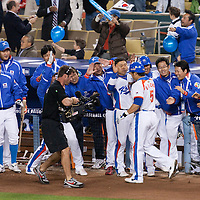 23 March 2009: #5 Shin Soo Choo of Korea celebrates with teammates after hitting a home run  during the 2009 World Baseball Classic final game at Dodger Stadium in Los Angeles, California, USA. Japan defeated Korea 5-3