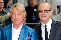 Bula Quo UK film premiere.  <br /> Rick Parfitt and Francis Rossi attend premiere of Status Quo action film featuring 12 of the rock band's classic tracks. Directed by former stunt co-ordinator Stuart St Paul, starring Jon Lovitz, Craig Fairbrass, Laura Aikman and the band members themselves. Released July 5. Odeon West End, London, United Kingdom.<br /> Monday, 1st July 2013<br /> Picture by Chris Joseph / i-Images