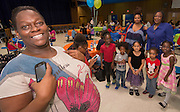 Houston ISD staff, parents and students gather for a meeting of the Home Instruction for Parents of Pre-K Youth (HIPPY) at Jordan High School, June 26, 2014.