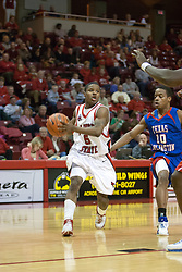 "02 December 2006: Cardell Hunter hustles to keep up with Keith ""Boo"" Richardson. In a non-conference game, the Mavericks of University of Texas at Arlington lost to the Redbirds home 86-61. The win was the 5th in a row for the Redbirds, the longest winning streak in 6 years. the game was played at Redbird Arena in Normal Illinois on the campus of Illinois State University.<br />"