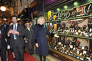 THE DUCHESS OF CORNWALL  MEETING GUESTS AND SHOPKEEPERS, The Duchess of Cornwall switches on the Christmas lights at the Burlington Arcade in Piccadilly, London, November 23,  London. 23 November 2011.