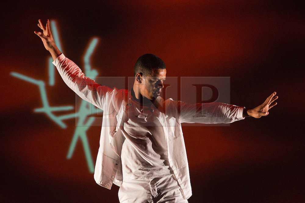 """© Licensed to London News Pictures. 27/06/2013. London, England. Brazilian choreographer and dancer Jean Abreu (Jean Abreu Dance) performs his latest show """"Blood"""" featuring images by Gilbert & George, the first time the iconic duo have allowed their art to be used in 42 year. Visuals are from Gilbert & George's """"The Fundamental Pictures"""", """"Rudimentary Pictures"""" and """"New Testamental Pictures"""". Performances at the Linbury Studio Theatre, Royal Opera House, London on 27 and 28 June 2013. Photo credit: Bettina Strenske/LNP"""