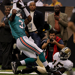 2009 September 03: Miami Dolphins cornerback Sean Smith (31) comes down with a interception over New Orleans Saints wide receiver Courtney Roby (15)during a preseason game between the Miami Dolphins and the New Orleans Saints at the Louisiana Superdome in New Orleans, Louisiana.