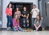 """Laconia Academy's Everyday Science students try out the """"CO2 Drag Racers"""" they built in their evening Adult Education course. (l-r Courtney St. Germain, Caroline Maddocks, Tiarnan McConnell, and Jacob Olisky. Seated Christina Chioccola and Jill Fitts.    (Karen Bobotas/for the Laconia Daily Sun)"""