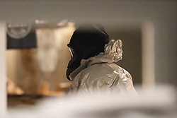 © Licensed to London News Pictures. 06/03/2018. Salisbury, UK. A police officer in a protective suit and gas mask is seen inside Zizzi's restaurant in Salisbury, Wiltshire, where former Russian spy Sergei Skripal and his daughter visited before becoming ill with suspected poisoning. The couple where found unconscious on bench in Salisbury shopping centre. Specialist units have been called in to deal with any possible contamination. Photo credit: Peter Macdiarmid/LNP