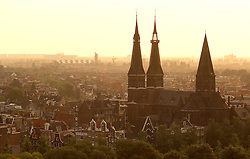 sunrise,city,amsterdam,europe,chruch,spire,town,aerial,yellow,early,trees,landscape