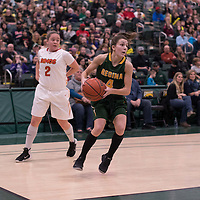2nd year guard Avery Pearce (4) of the Regina Cougars in action during the home game on January  28 at Centre for Kinesiology, Health and Sport. Credit: Arthur Ward/Arthur Images