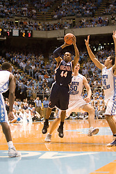 Virginia's Sean Singletary (44) shoots a jumper between three UNC defenders.  The #1 ranked Tar Heels beat the Cavaliers 79-69 to improved to 15-1 overall, 2-0 ACC on January 10, 2007 at the Dean Smith Center in Chapel Hill, NC...<br />