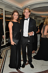 Model LUCY PINDER and FREDDIE HUNT son of the late F1 World Champion James Hunt at the David Shepherd Wildlife Foundation 30th anniversary Wildlife Ball at The Dorchester, Park Lane, London on 10th October 2014.
