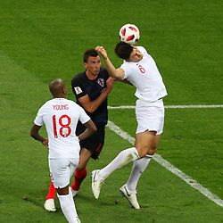July 11, 2018 - Moscow, Russia - July 11, 2018, Moscow, FIFA World Cup 2018 Football, the playoff round. 1/2 finals of the World Cup. Football match Croatia - England at the stadium Luzhniki. Player of the national team Mario Mandzhukic; Harry Maguire. (Credit Image: © Russian Look via ZUMA Wire)