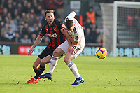 Football - 2018 / 2019 Premier League - AFC Bournemouth vs. Wolverhampton Wanderers<br /> <br /> Diogo Jota of Wolverhampton Wanderers pushes Bournemouth's Dan Gosling off the ball during the Premier League match at the Vitality Stadium (Dean Court) Bournemouth  <br /> <br /> COLORSPORT/SHAUN BOGGUST