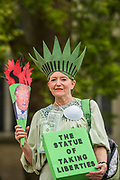 The Statue of Taking Liberties during speeches at Old Palace Yard - Trump & May Climate Disaster protest in support of the US climate march today. As Trump reaches his first 100 days and pushes to slash the US climate research budget. In the UK the government has been reducing budgets and appears to be veering away from Climate Act commitments by forcing through a 3rd runway at Heathrow.