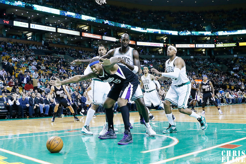 30 January 2013: Sacramento Kings center DeMarcus Cousins (15) vies for a loose ball with Boston Celtics power forward Kevin Garnett (5) during the Boston Celtics 99-81 victory over the Sacramento Kings at the TD Garden, Boston, Massachusetts, USA.