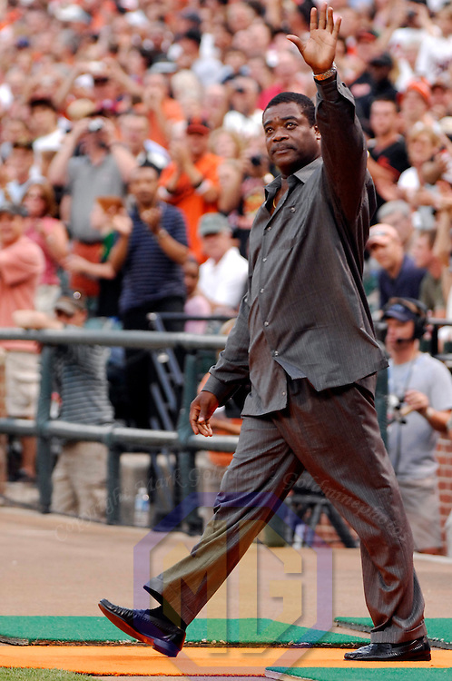 24 July 2007:  Former Baltimore Oriole first baseman and Hall of Famer Eddie Murray waves to the crowd as he comes out to pay tribute to Cal Ripken Jr. during the Orioles Hall of Fame send off celebration prior to the game between the Tampa Bay Devil Rays and the Baltimore Orioles.  The Orioles defeated the Devil Rays 3-0 at Camden Yards in Baltimore, MD.   ****For Editorial Use Only****