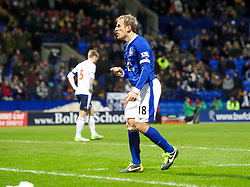 BOLTON, ENGLAND - Saturday, January 26, 2013: Everton's captain Phil Neville hurls a volley of abuse at the celebrating Everton fans after John Heitinga's late winning second goal against Bolton Wanderers during the FA Cup 4th Round match at the Reebok Stadium. (Pic by David Rawcliffe/Propaganda)