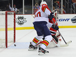 Feb 11; Newark, NJ, USA; Florida Panthers left wing Sean Bergenheim (20) scores a goal on New Jersey Devils goalie Martin Brodeur (30) during the first period at the Prudential Center.