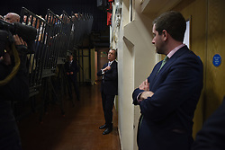 "© London News Pictures. ""Looking for Nigel"". A body of work by photographer Mary Turner, studying UKIP leader Nigel Farage and his followers throughout the 2015 election campaign. PICTURE SHOWS - Nigel Farage, waits in the wings to go on stage and give a speech at a public meeting at the Haven High Academy, in Boston Lincolnshire following a gruelling two days travelling around the Midlands, on April 8th 2015. . Photo credit: Mary Turner/LNP **PLEASE CALL TO ARRANGE FEE** **More images available on request**"