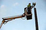 An engineer in a cherry picker installs a radio transmitter dish  in North Yorkshire which will beam a broadband link - using radio waves - to a nearby village.
