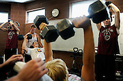 A section of the Chatfield Senior High School football team lift weights before after school practice, on Monday, Aug. 16, 2010, in Jefferson County, Colo.