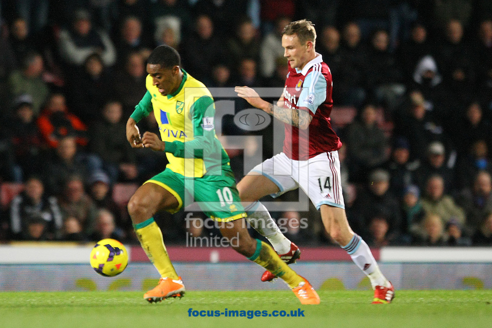 Picture by Paul Chesterton/Focus Images Ltd +44 7904 640267<br /> 11/02/2014<br /> Leroy Fer of Norwich and Matt Taylor of West Ham in action during the Barclays Premier League match at the Boleyn Ground, London