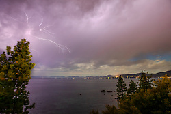"""""""Lightning at Lake Tahoe 2"""" - Photograph of a lightning strike at Lake Tahoe, shot at night from the Hidden Beach area."""