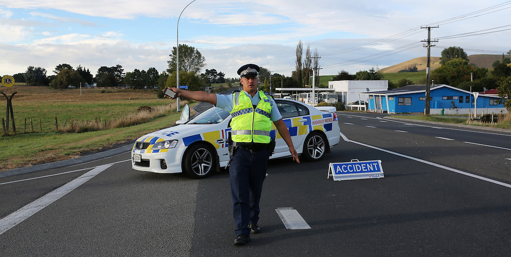 Police put a diversion in place a after one is dead and another trapped in a head on collision at Waimahana on State Highway 5 near the Mihi Bridge Reporoa, Rotorua, New Zealand, Sunday, March 23, 2014. Credit:SNPA / Peter Graney.