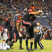24 November 2018: San Diego State Aztecs defensive lineman Anthony Luke (45) celebrates after stopping Hawaii Warriors running back Miles Reed (26) on a third down plays in the redzone. The Aztecs closed out the season with a 31-30 overtime loss to Hawaii at SDCCU Stadium.
