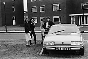 Teenage girls standing with Rover car, Keele University, UK, 1983