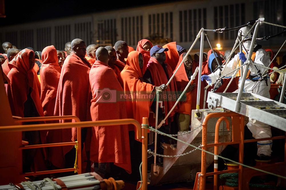 October 6, 2018 - Malaga, Spain - A group of migrants disembarking the Spanish vessel at the Malaga's port, on October 6, 2018, Malaga. (Credit Image: © Guillaume Pinon/NurPhoto/ZUMA Press)