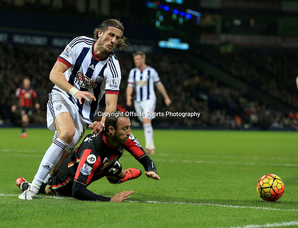 19th December 2015 - Barclays Premier League - West Bromwich Albion v AFC Bournemouth - Glen Murray of AFC Bournemouth goes down under pressure from Jonas Olsson of West Bromwich Albion - Photo: Paul Roberts / Offside.