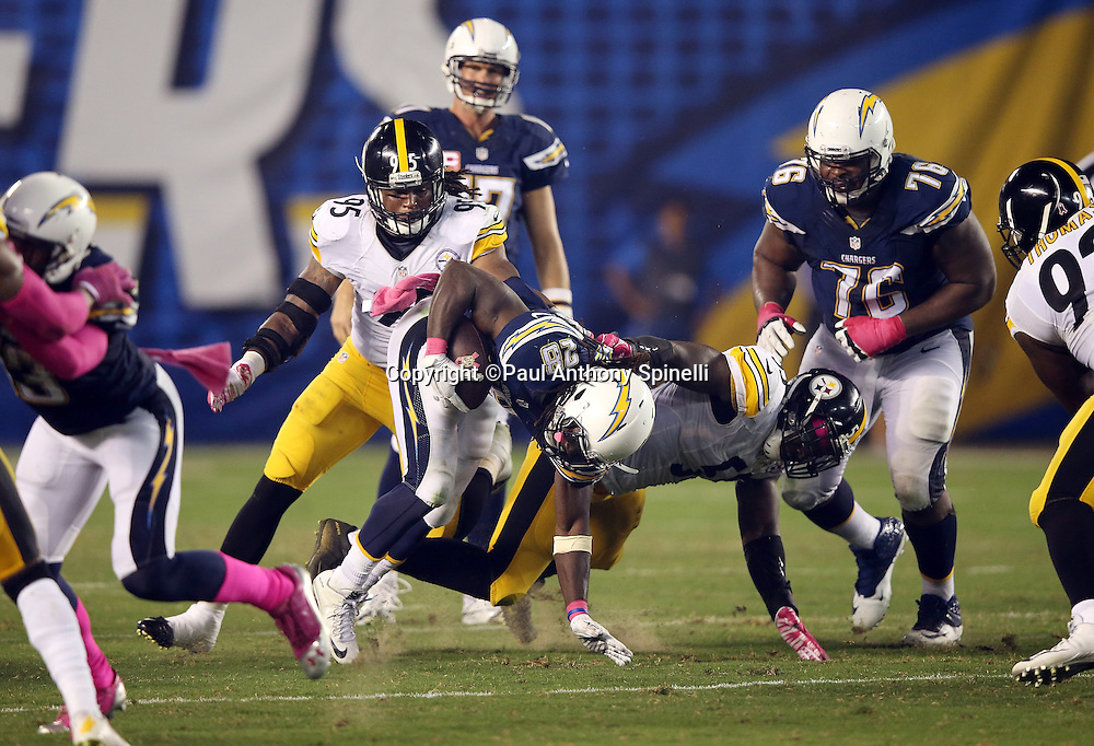 San Diego Chargers running back Melvin Gordon (28) gets tackled by Pittsburgh Steelers outside linebacker Arthur Moats (55) as he runs the ball in the fourth quarter during the 2015 NFL week 5 regular season football game against the Pittsburgh Steelers on Monday, Oct. 12, 2015 in San Diego. The Steelers won the game 24-20. (©Paul Anthony Spinelli)