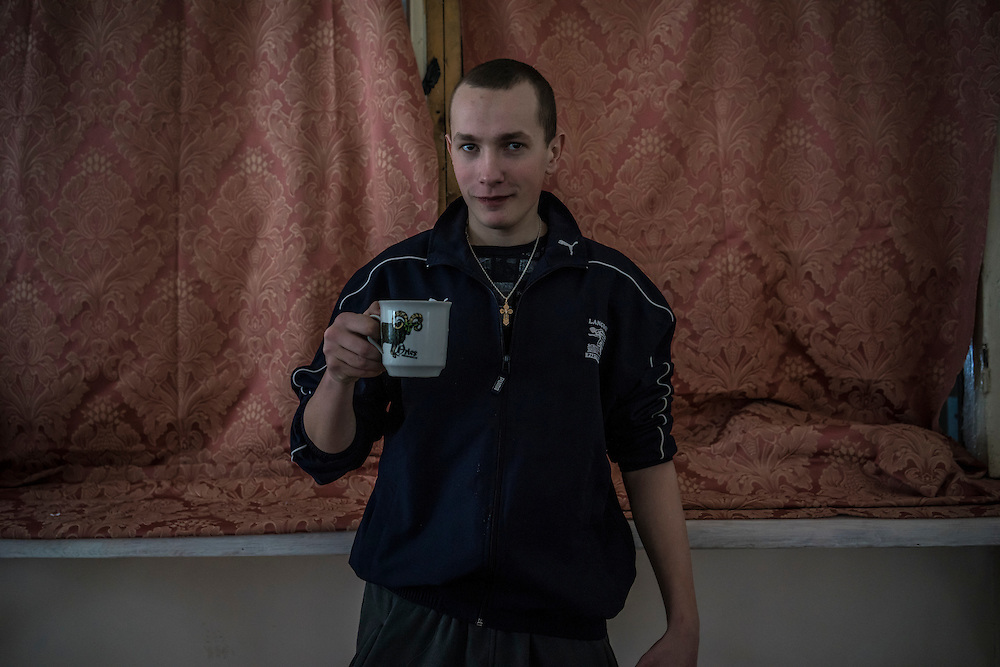 A security guard poses for a portrait at Romashka, a summer camp where he and several hundred other people live after being displaced by fighting in Eastern Ukraine on Friday, February 13, 2015 in Kharkiv, Ukraine.
