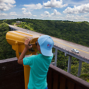 The Bacunayagua Bridge over the Yumuri Valley on the Via Blanca highway  in Matanzas. There bridge built before the Revolucion is the main road to Varadero.  Photography by Jose More
