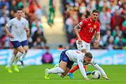 Ross Barkley of England is brought down by Kiril Despodov of Bulgaria during the UEFA European 2020 Qualifier match between England and Bulgaria at Wembley Stadium, London, England on 7 September 2019.