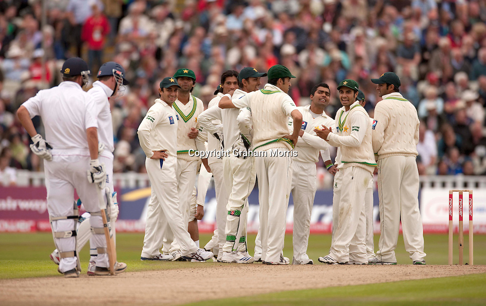 Celebrations after the referral shows that Andrew Strauss is caught behind off Mohammad Amir during the second npower Test Match between England and Pakistan at Edgbaston, Birmingham.  Photo: Graham Morris (Tel: +44(0)20 8969 4192 Email: sales@cricketpix.com) 06/08/10