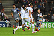 Lincoln City midfielder Harry Anderson (26) takes a shot at goal during the EFL Sky Bet League 1 match between Milton Keynes Dons and Lincoln City at stadium:mk, Milton Keynes, England on 20 August 2019.
