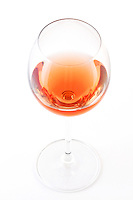 Glass of rose wine on white bacground