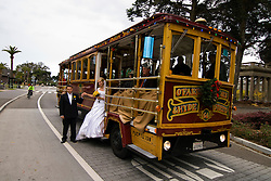 California: San Francisco Christmas in Golden Gate Park. Couple getting married on motorized cable car. Photo copyright Lee Foster.  Photo # 32-casanf75965