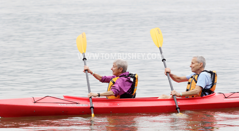 New Windsor, New York - An elderly couple paddle their kayak take to the Hudson River at the Paddlefest event sponsored by the Mid-Hudson Chapter of the Adirondack Mountain Club at Kowawese Unique Area at Plum Point on  Sunday, June 13, 2010.