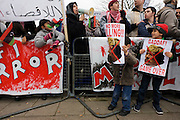 Libyan exile children demand death for dictator Gaddafi during protests opposite London Libyan embassy during the uprising.