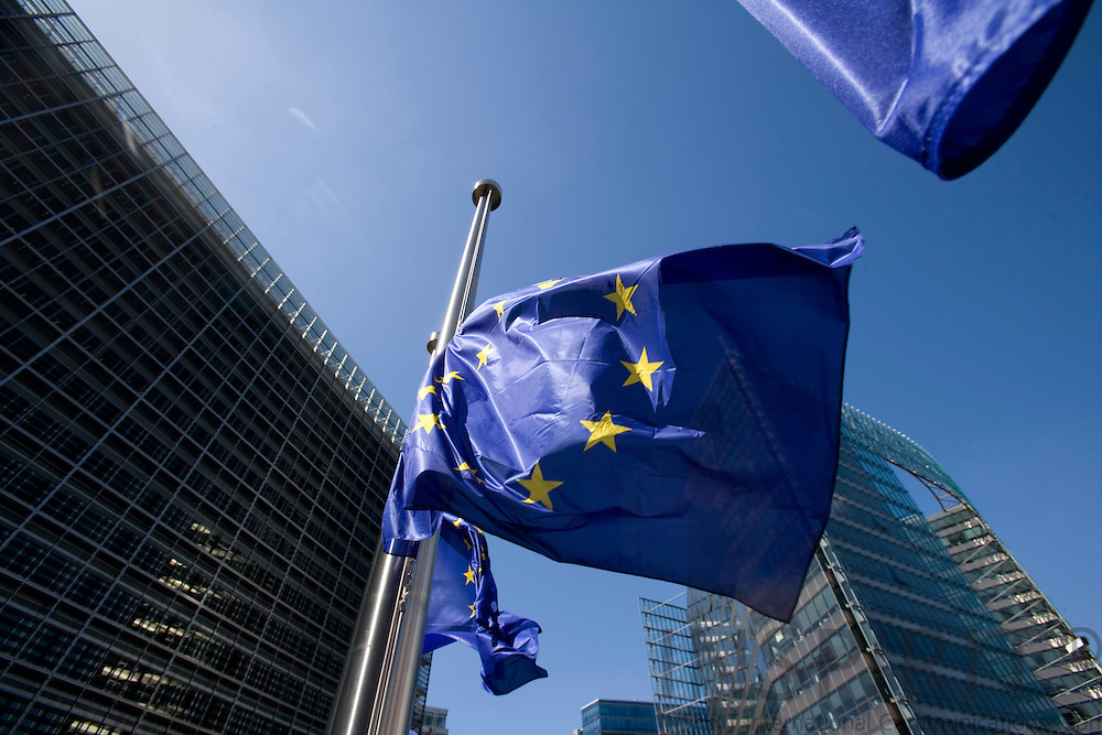 BRUSSELS - BELGIUM - 23 JUNE 2008 -- The European Union flag. At the left side the Berlaymont and on the right the Charlemagne building.  Photo: Erik Luntang/INSPIRIT Photo