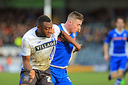 Nathan Cameron, James Hooper during the The FA Cup match between Rochdale and Bury at Spotland, Rochdale, England on 6 December 2015. Photo by Daniel Youngs.