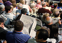 """A Berkshire Hathaway shareholder reads a local paper with the headline """"With Sokol out who might be in? """" referring to the David Sokol scandal before the company's annual meeting in Omaha, Nebraska April 30, 2011.  REUTERS/Rick Wilking  (UNITED STATES)"""