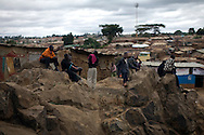 Residents make their way through life in the Kibera slum of Nairobi, Kenya June , 2008.Kibera is home to nearly 1million people living in an area roughly the size of New York's Central Park with sprawling market places and  PHOTO BY KEITH BEDFORD