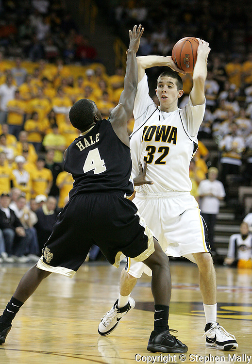 26 NOVEMBER 2007: Iowa guard Jake Kelly (32) tries to pass the ball over Wake Forest guard Harvey Hale (4) in Wake Forest's 56-47 win over Iowa at Carver-Hawkeye Arena in Iowa City, Iowa on November 26, 2007.