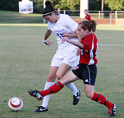 UVA's Alex Singer (#19) fights off NC State in Virginia's 2-0 victory over North Carolina State.