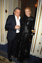 CARLOS ALMADA and FIONA SCARRY at a party to celebrate the launch of The Essential Party Guide held at the Mandarin Oriental Hyde Park, 66 Knightsbridge, London on 27th March 2007.<br />